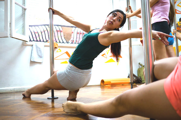 pole fitness Miami dancing strength women bachelorette parties unique exercise