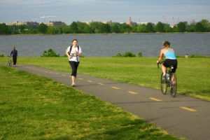 a woman jogging on a section of the mt. vernon trail in washington dc