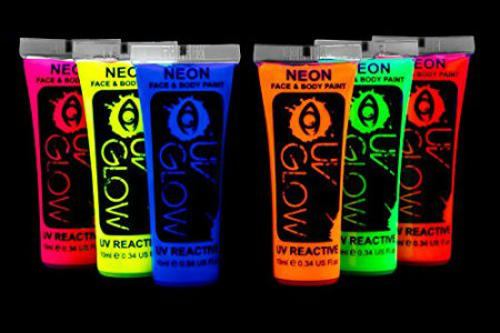 tubes of glow in the dark body paint colors pink yellow blue orange green red from left to right