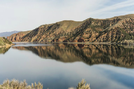 Reflection of the mountains on the water of Echo Reservoir