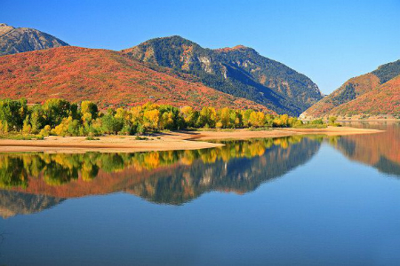 Beautiful fall day on the shores of Pineview with the mountains reflecting off the water