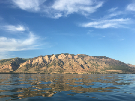The tall mountain ranges and glassy waters of Willard Bay